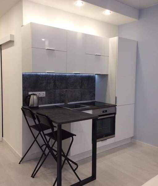 Как выглядит микроквартира-студия 18 кв.м. Спальня и кухня в одной комнате?